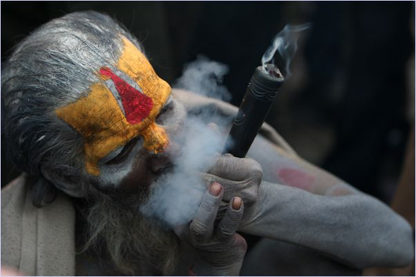 man-with-painted-face-hair-smoking-ganga-in-unusuaul-pipe