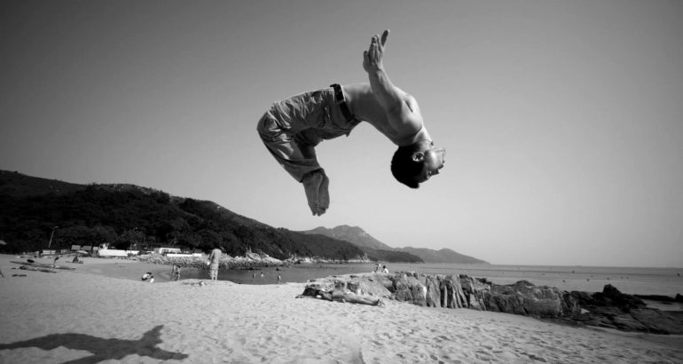 parkour beach backflip