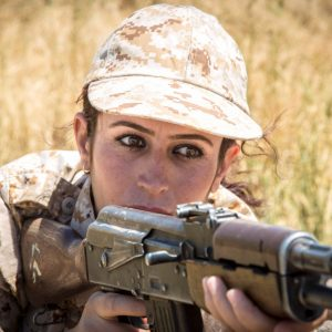 SULAYMANIYAH, IRAQ - JULY 29: A Woman Peshmerga of the 2nd Battalion takes part in a military exercise on July 29, 2014 in Sulaymaniyah, Iraq. Dressed head-to-toe in army fatigues with rifles over their shoulders, these are the female fighters of the Peshmerga ready to lay down their lives in combat against the Islamic State. In the scorching heat on the outskirts of Sulaymaniyah, Kurdistan, they carry out routine exercises and look no different from other Kurdish fighters. The 2nd Battalion consists of 550 mothers, sisters and daughters and is led by Colonel Nahida Ahmad Rashid. PHOTOGRAPH BY Vianney Le Caer / Pacific Press / Barcroft India UK Office, London. T +44 845 370 2233 W www.barcroftmedia.com USA Office, New York City. T +1 212 796 2458 W www.barcroftusa.com Indian Office, Delhi. T +91 11 4053 2429 W www.barcroftindia.com